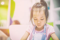Asian girl is learning art in classroom. Vitnage tone Stock Image