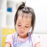 Asian girl is learning art in classroom. Asian girl wearing apron is learning art in classroom Royalty Free Stock Photo
