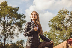 Asian girl in leather jacket. Girl Asian girl in a leather jacket stands on the nature Stock Images