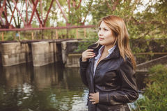 Asian girl in leather jacket. Girl Asian girl in a leather jacket stands on the nature Royalty Free Stock Photography
