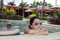 An asian girl leisurely in the swimming pool Royalty Free Stock Photos