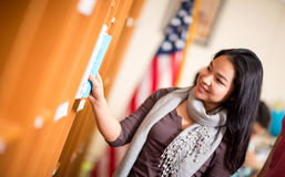 Asian girl in library Stock Images