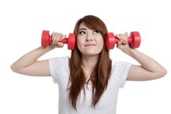 Asian girl lift dumbbells think of something Stock Photos