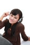 Asian girl listening music Stock Photos