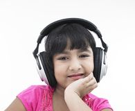 Asian girl listening to music Royalty Free Stock Photos