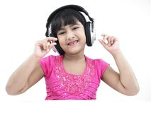 Asian girl listening to music Royalty Free Stock Image