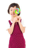 Asian girl. Little girl holding lollipop candy with smiling face Royalty Free Stock Photography