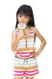 Asian girl with lollipop. Isolated over white Royalty Free Stock Photo