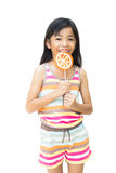 Asian girl with lollipop. Isolated over white Stock Image