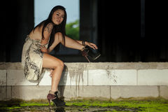 Sensual asian woman with tattoo in long dress and high heels royalty free stock photography