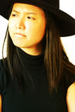 Asian girl with long hair. Portrait of a young beautiful asian woman with long hair and a black hat on. Fit for worry, sad, pessimist, who-cares, snobbish, non royalty free stock photo
