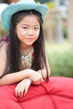 Asian girl with long hair wearing blue cowboy hat Royalty Free Stock Photo