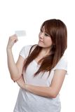 Asian girl look at a blank card in her hand Stock Images