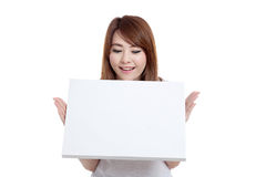 Asian girl look at blank sign in front of her Stock Images