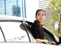 Asian girl looking at back of car Stock Photography