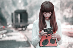 Asian girl looking at photos Royalty Free Stock Image