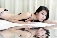 Asian girl lying on bed Stock Photo