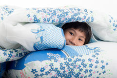 Asian girl lying under a blanket in the bed Stock Photography