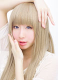 Asian girl make up fashion isolated hand on face Royalty Free Stock Photos