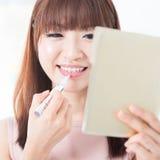 Asian girl make up Royalty Free Stock Photography