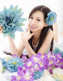 Asian girl make up spa model in flowers Stock Image