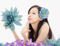 Asian girl make up spa model in flowers Royalty Free Stock Photography