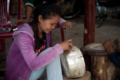 Asian girl makes a figure on silver bowl Stock Photo