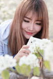 Asian girl making pictures of flowers Stock Photos