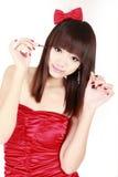 Asian girl making up Stock Photos