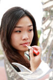 Asian girl making up Stock Photo