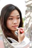 Asian girl making up stock photo