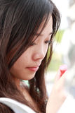 Asian girl making up. Stock Photography