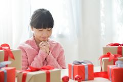 Asian girl making a wish for Christmas. Royalty Free Stock Images