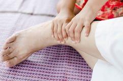 Asian Girl massage her grandmother. Asian Girl massage her grandmother by her hands Royalty Free Stock Photos