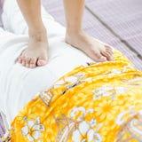 Asian Girl massage her grandmother. Asian Girl massage her grandmother by her legs Stock Image