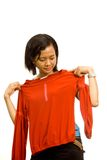 Asian girl measure an outfit Stock Images