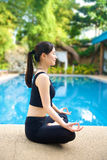 Asian Girl meditating yoga Stock Photos