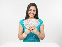 Asian girl with money Stock Images