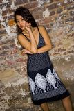 Asian girl near brick wall Stock Photography