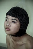 Asian girl with netting Stock Photography