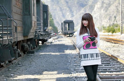 Asian girl next to train Stock Photos