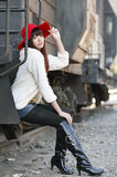 Asian girl next to train. Asian fashion girl posing next to old train caboose Stock Image