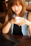 Asian girl, notebook and coffee Stock Images
