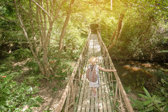 Asian girl on the old bridge. In the forest Stock Images