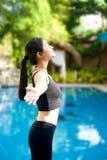 Asian Girl open arms relaxing at pool Stock Photos