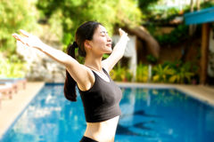 Asian Girl open arms relaxing at pool Stock Photography