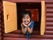 Asian girl open window and smile Royalty Free Stock Images