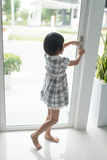 Asian girl opend door at home. Royalty Free Stock Images