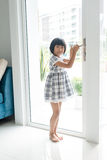 Asian girl opend door at home. Stock Image