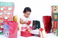 Asian girl opening Christmas presents Stock Photos